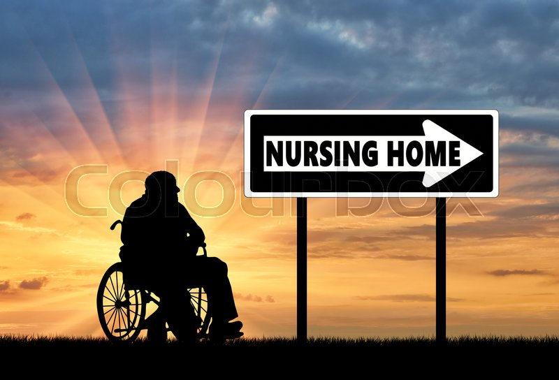 Stock image of 'Silhouette of an elderly man in a wheelchair next to the road sign pointer home for elderly'