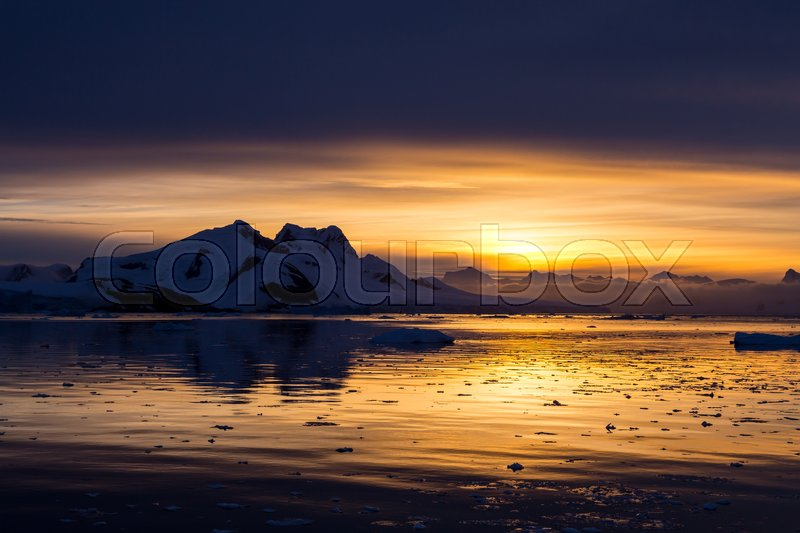 Stock image of 'Sunset in the middle of Lemaire Channel, Antarctica'