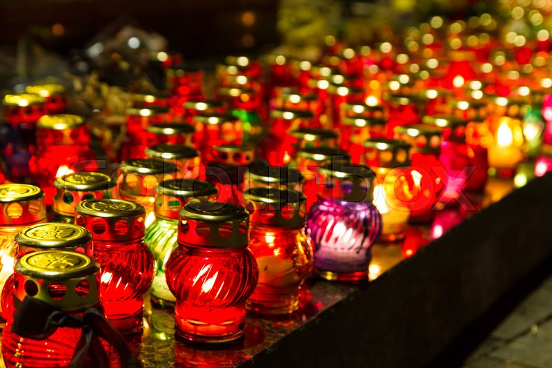 Stock image of 'Burning candles lamps at night'