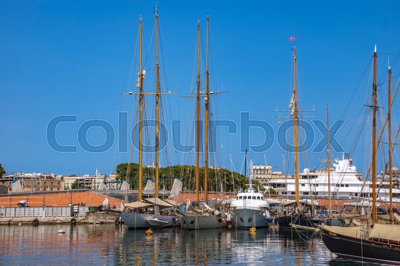 Editorial image of 'BARCELONA, SPAIN - JULY 4, 2016: Yachts and sailboats moored in the Port Vell of Barcelona, Catalonia, Spain'