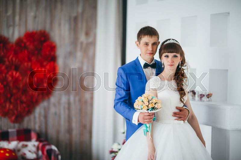 Stock image of 'young bride and groom in interior design studio.'