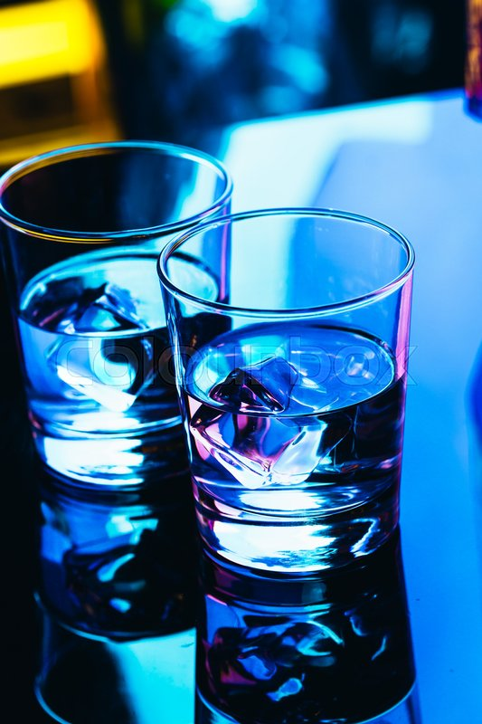 Stock image of 'drinking glasses close-up on a dark background.'