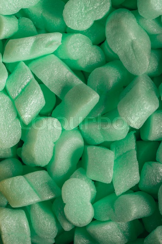 Stock image of 'pieces of green styrofoam in carton box background.'