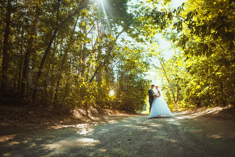 Stock image of 'bride and groom on the forest background.'