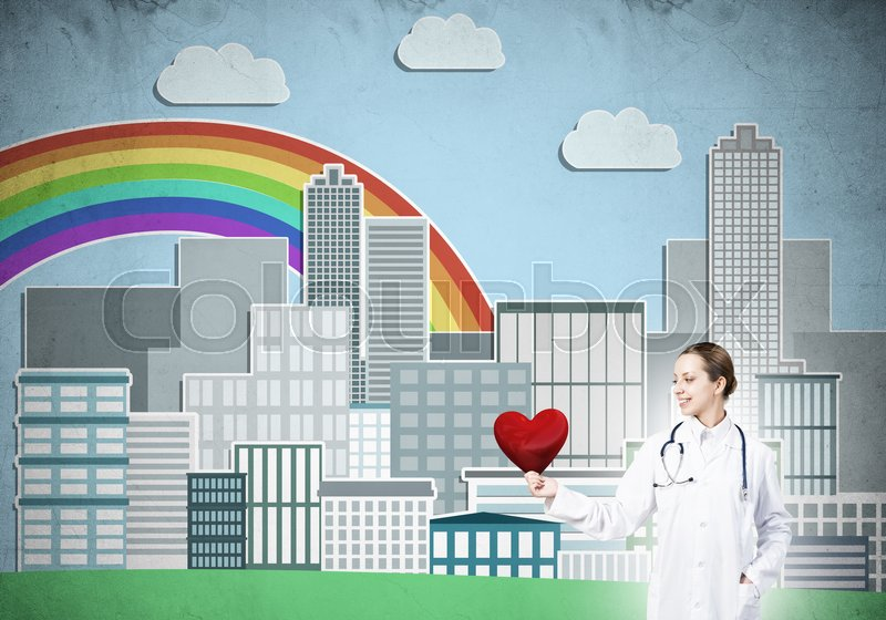 Stock image of 'Young woman doctor against illustration background holding red heart'