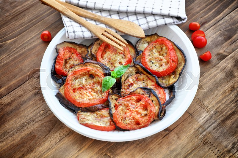 Stock image of 'Baked eggplant with tomatoes as tasty vegetarian pizza topping, main course in a holiday day, traditional italian food, organic nutrition'