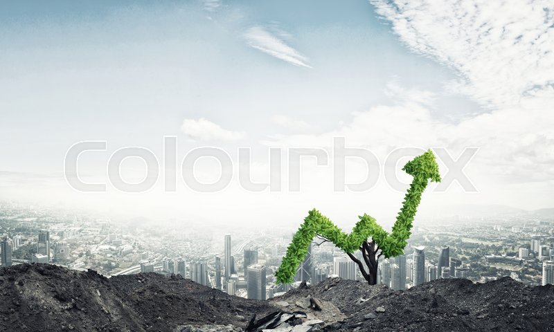 Stock image of 'Market growth and success as growing green tree in shape of arrow'