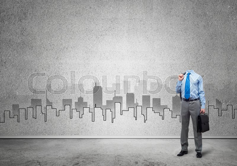 Stock image of 'Headless engineer man with case in hand against construction background'