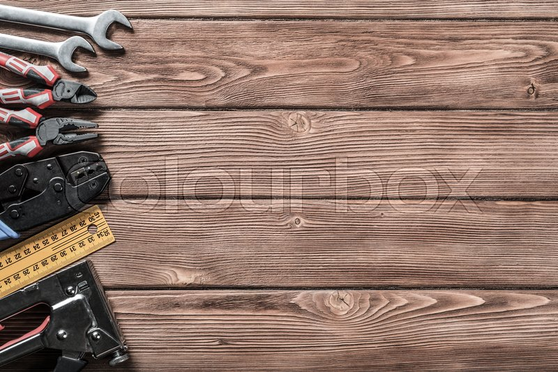 Stock image of 'Variety of repair tools on wooden surface and place for text'