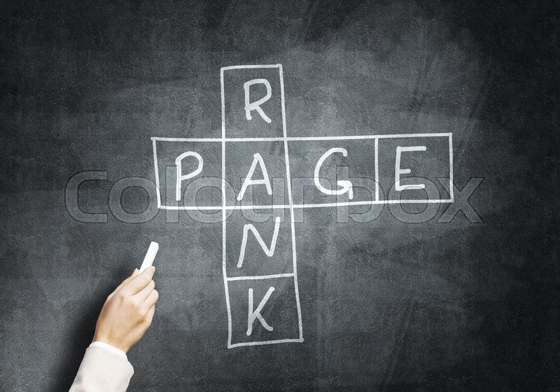 Stock image of 'Studying concept with crossword drawn with chalk on blackboard'