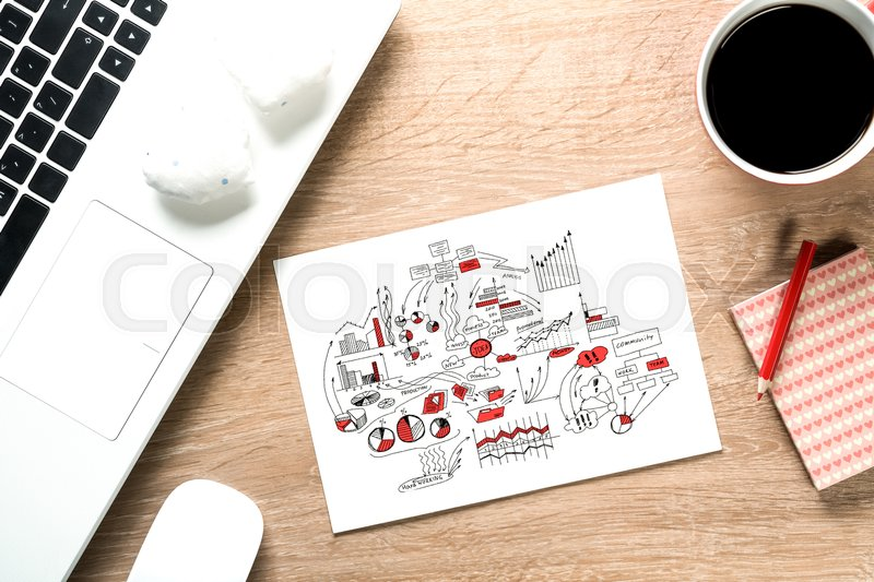 Stock image of 'Keyboard notepad with sketches and coffee cup on wooden desk'