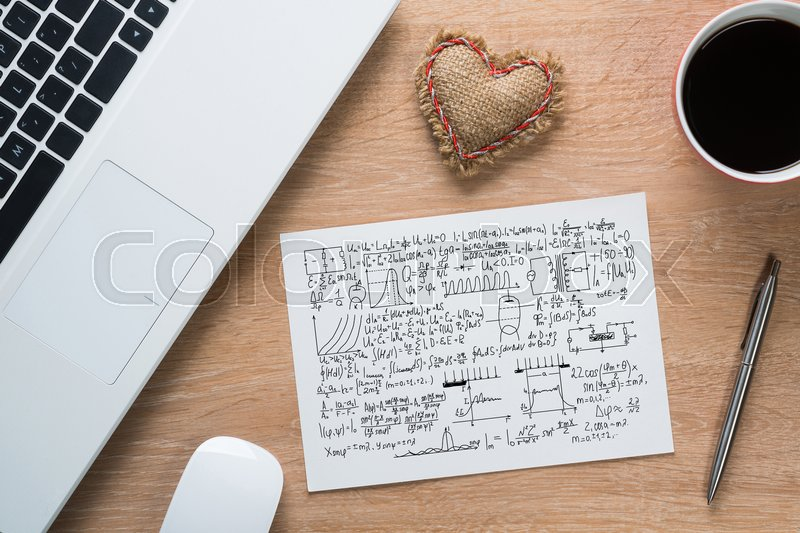 Stock image of 'Keyboard notepad and coffee cup on wooden desk'