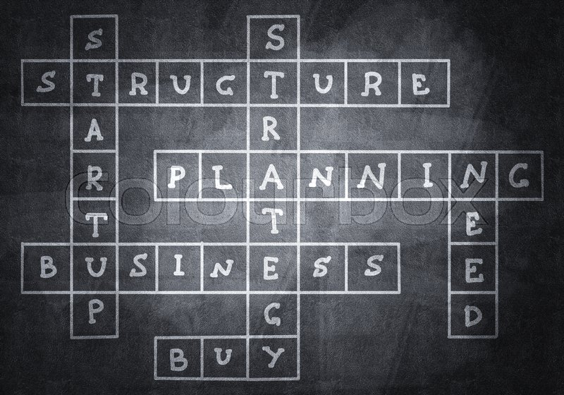 Stock image of 'Studying concept with crossword drawn on blackboard'