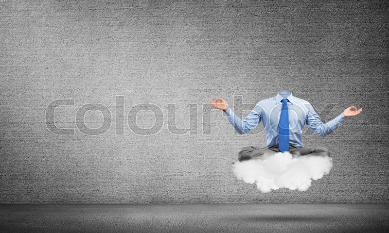 Stock image of 'Headless businessman sitting on cloud in lotus pose and meditating'
