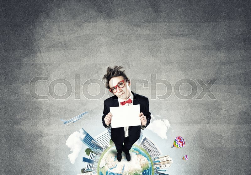 Stock image of 'Top view of funny businessman in red glasses showing blank paper sheet. Elements of this image are furnished by NASA'