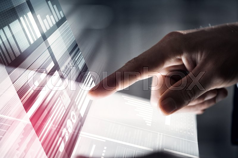Stock image of 'Businessman hand touching with finger virtual panel with infographs'