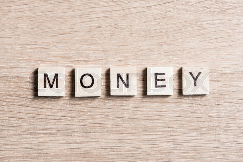 Stock image of 'Business money word collected of elements of wooden elements with the letters'