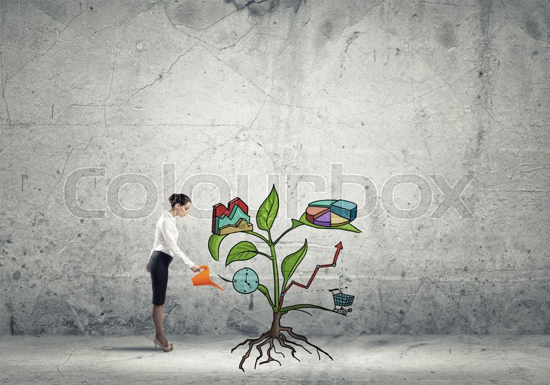 Stock image of 'Young businesswoman on concrete background watering growing sprout with can'