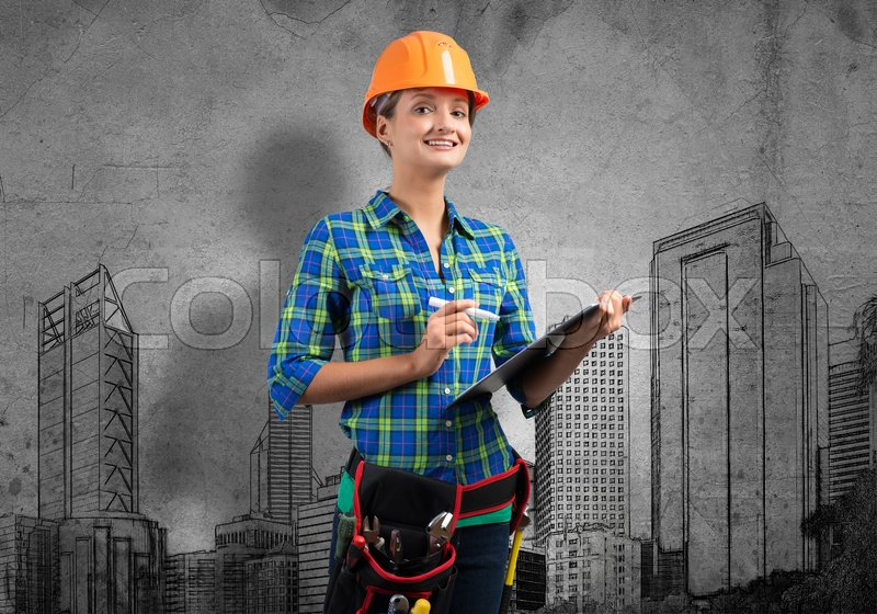 Stock image of 'Engineer woman with folder and sketches of construction project on wall'