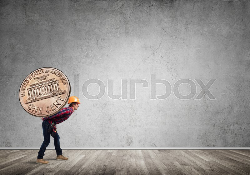 Stock image of 'Builder man carrying on his back big cent coin'