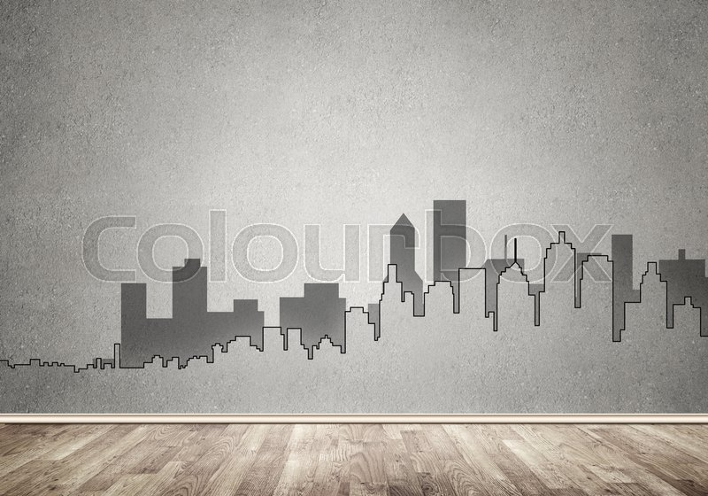Stock image of 'Silhouette of modern city landscape drawn on concrete wall'