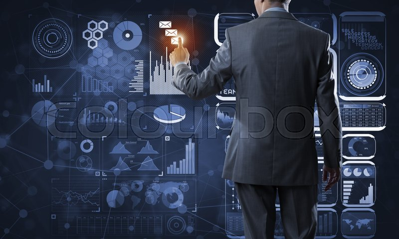 Stock image of 'Back view of businessman working with virtual panel'