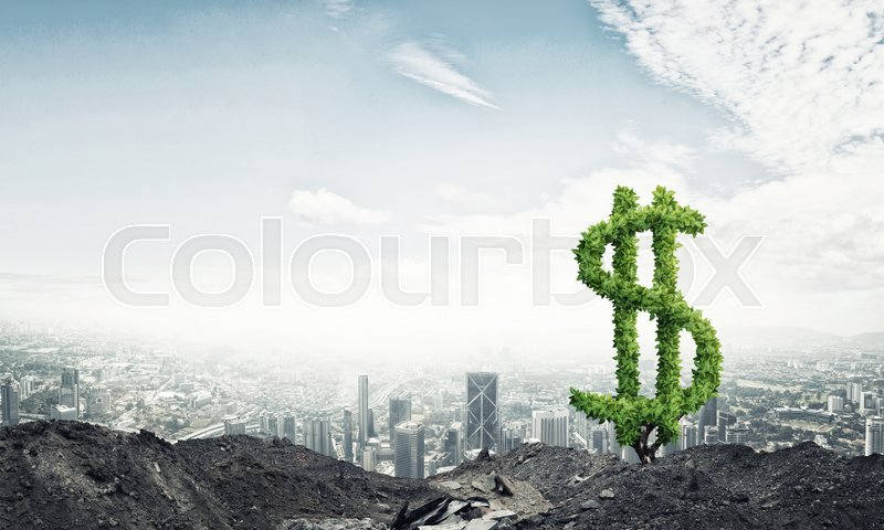 Stock image of 'Market growth and success as growing green tree in shape of dollar'