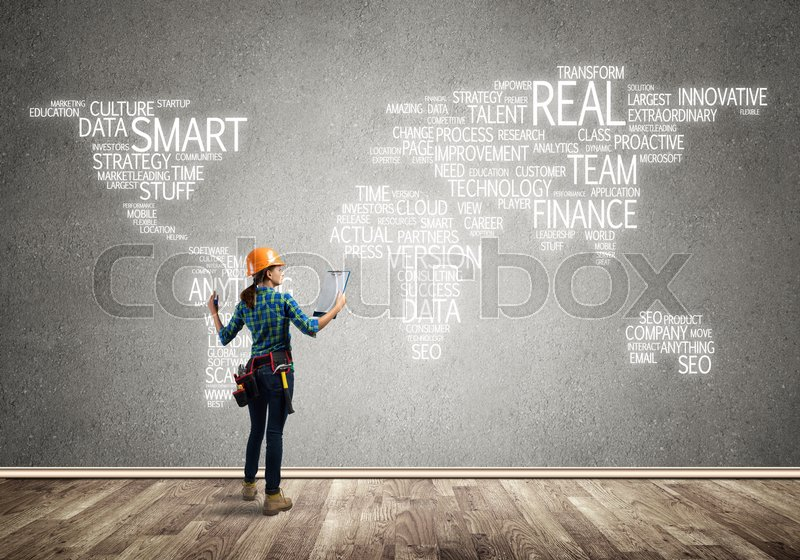 Stock image of 'Female construction worker in room and globalization concept'