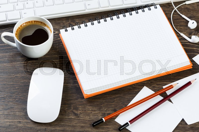 Stock image of 'Business items notepad and stationary on wooden table'