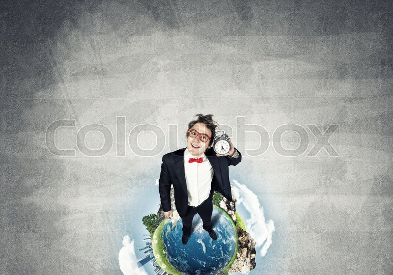 Stock image of 'Funny disheveled businessman with alarm clock from top view. Elements of this image are furnished by NASA'
