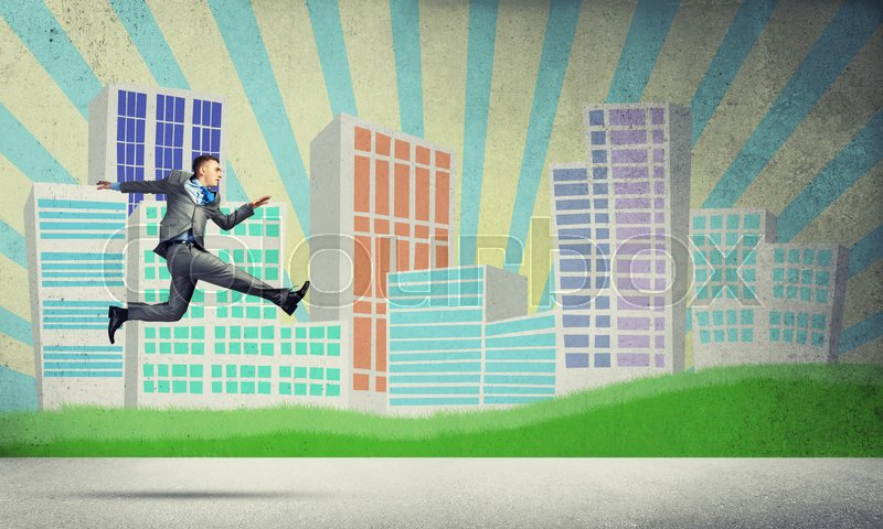 Stock image of 'Young businessman against city background running in a hurry'