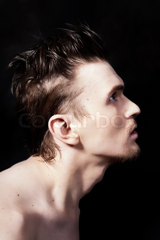 profile of a young handsome man on black background stock photo