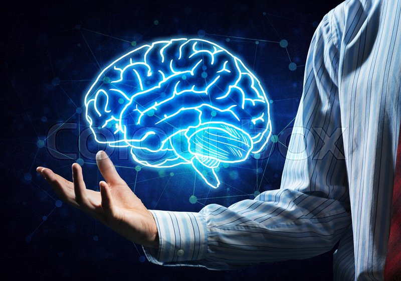 Stock image of 'Close up of businessman hand holding brain in palm'