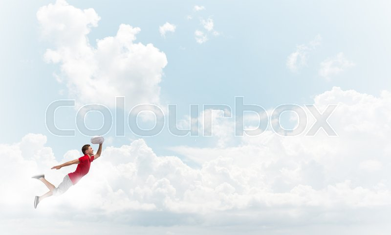 Stock image of 'Young cheerful man flying high in sky'