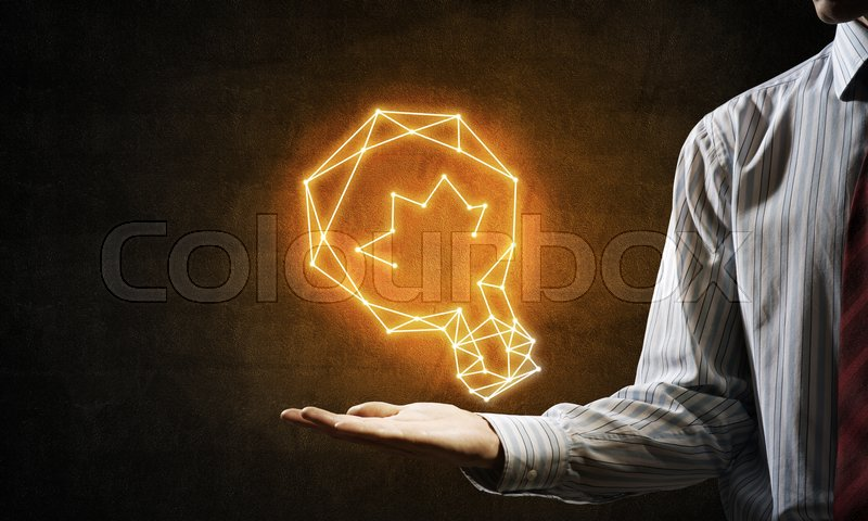 Stock image of 'Close of businessman hand holding glowing light bulb icon'