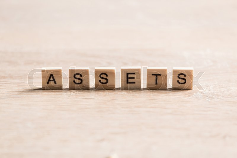 Stock image of 'wooden elements with the letters collected in the word assets'