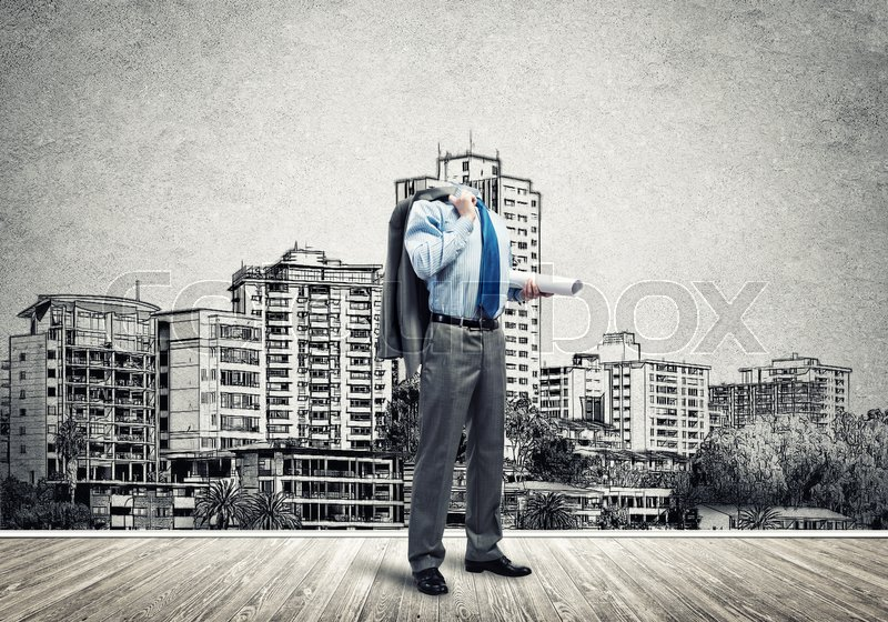 Stock image of 'Headless engineer man with papers in hand against construction background'