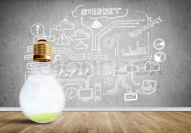 Stock image of 'Glass glowing light bulb and business sketched ideas on wall'