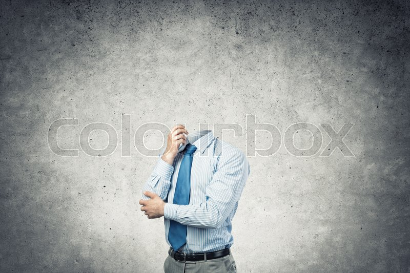 Stock image of 'Businessman without head and his arm on chin thinking something over'