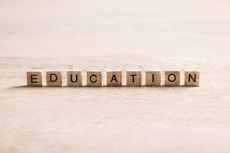 Stock image of 'Wooden elements with the letters collected in the word education'