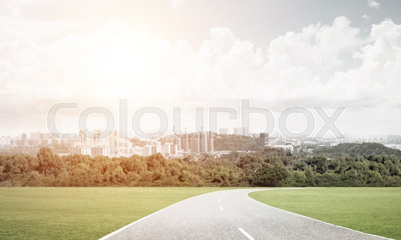 Stock image of 'Natural landscape of countryside road and modern city'