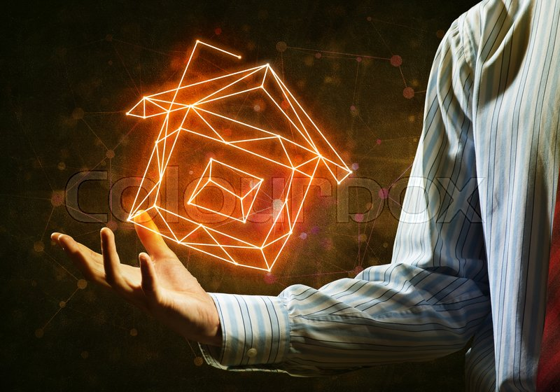 Stock image of 'Close of buinessman holding in palm glowing house symbol'