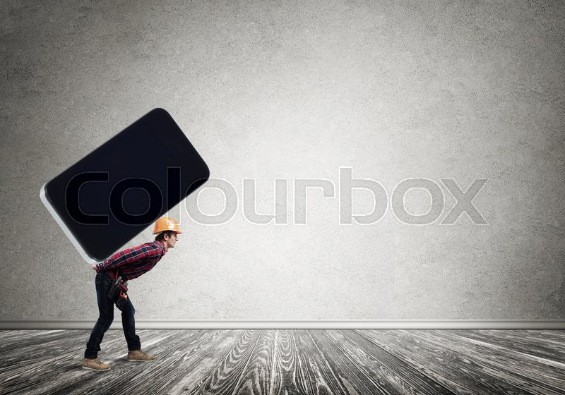 Stock image of 'Man engineer carrying on back big smartphone'