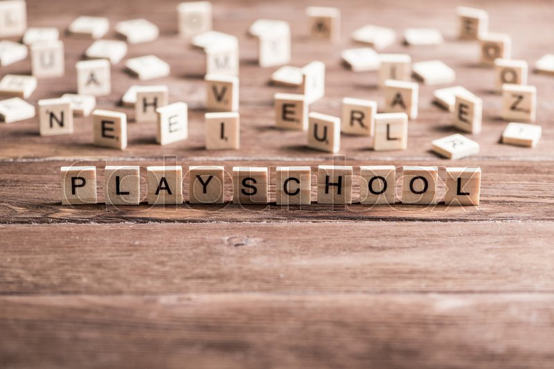 Stock image of 'Alphabet letters on wooden pieces collected word playschool'