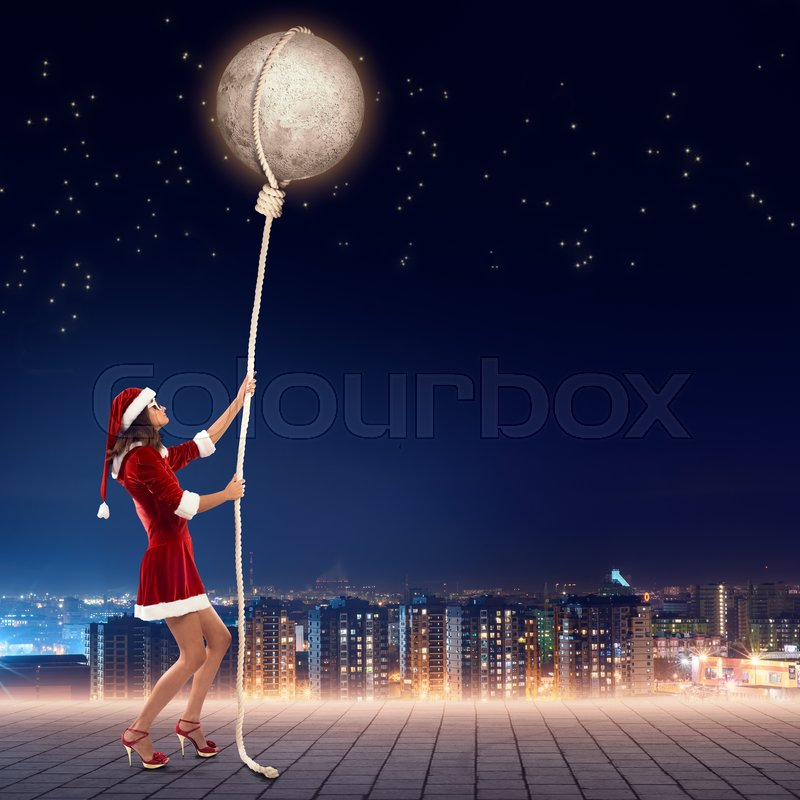 Stock image of 'Elegant Santa woman pulling moon planet on rope'