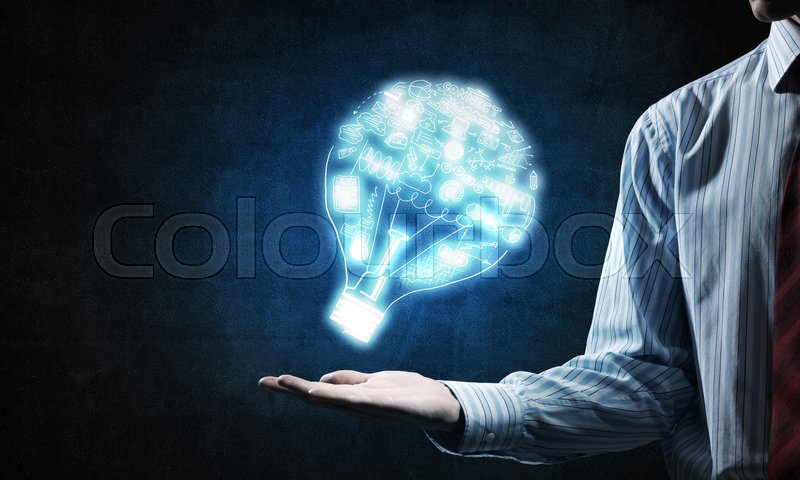 Stock image of 'Close of businessman showing sketched idea in palm'