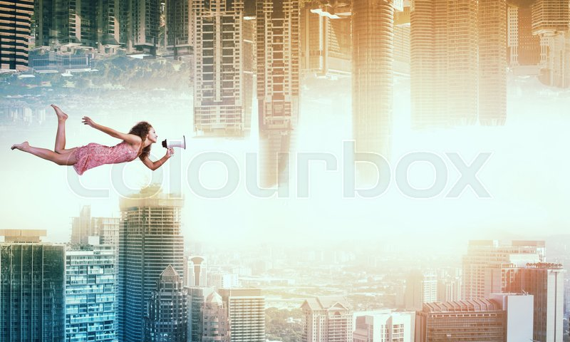 Stock image of 'Young woman flying between two reality worlds'