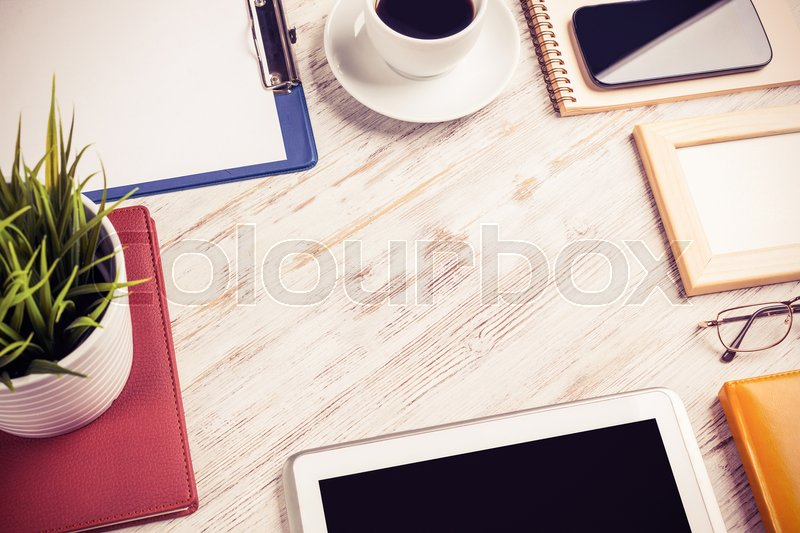 Stock image of 'Still life photo of tablet notepad coffee glasses on wooden table'