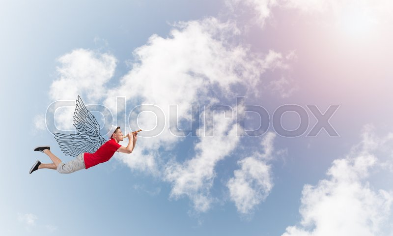 Stock image of 'Young cheerful man flying high in sky and playing fife'
