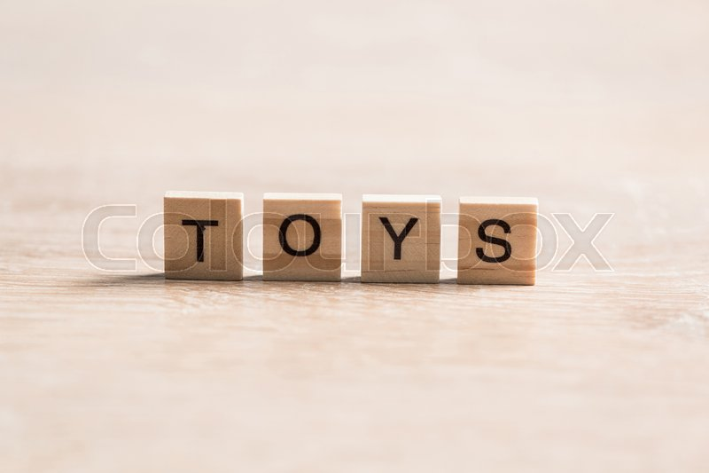 Stock image of 'wooden elements with the letters collected in the word toys'